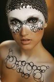 Portrait young woman with creative face-art — Stock Photo