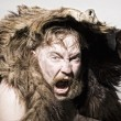 Caveman in bear skin — Stock Photo #4259667