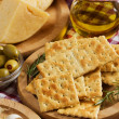 Crackers with cheese and olives - Stock Photo