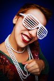 Gril with shutter shades — Stock Photo