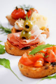 Bruschette, traditional italian appetizer food — Stockfoto