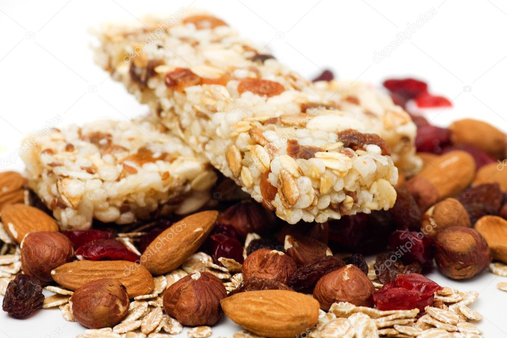 Granola bar with dried fruit and nuts on white background — Stock Photo #4025385