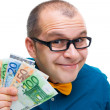 Happy man holding european money — Stock Photo