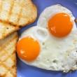Stock Photo: Heart shaped fried eggs