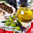 Olive oil with spices and food ingredients — Stock Photo