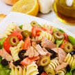 Tuna salad with pasta, green and black olives — Stock Photo