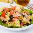 Classic tuna salad with pasta - Stock Photo