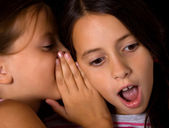 Young girls sharing a secret — Stock Photo