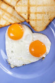 Fried eggs with toasted bread — Stock Photo