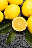 Lemon fruit on wet background — Stock Photo