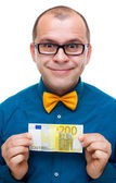 Happy man holding 200 euros — Stock Photo