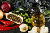 Extra virgin olive oil and mediterranean food ingredients — Stock Photo