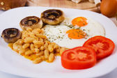 Fried eggs with beans, mushrooms and tomato — Stock Photo