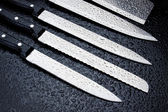 Stainless steel kitchen knives — Stock Photo