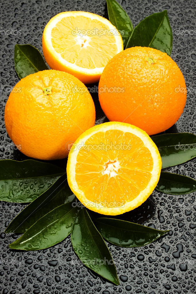Fresh orange citrus fruit on wet gray background — Stock Photo #5044118