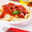 Italian macaroni pasta with tomato sauce — Stock Photo