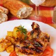 Pork loin chops with baked potato — Stock Photo