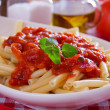 Macaroni pasta with tomato sauce and oregano — Stock Photo