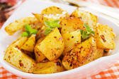 Roasted potato in white bowl — Stock Photo