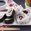 Sushi rolls over the table - Stock Photo