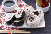 Sushi rolls over the table — Stock Photo