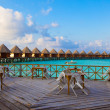 Empty terrace of restaurant and country house on water at ocean, Maldives — Stock Photo