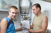 The concept of relations in a family. The father and the son-teenager toget — Stock Photo