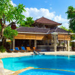 Stock Photo: Asia. tropical country house before pool