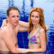 Young loving couple in pool — Stock Photo #4097570