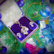 Foto de Stock  : On a New Year tree a gift - jewelry