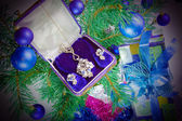 On a New Year tree a gift - jewelry — Stock Photo