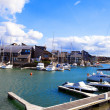 France, resort city Dovill. Boats in a bay before houses — Stock Photo #4197711