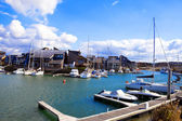 France, resort city Dovill. Boats in a bay before houses — Stock Photo