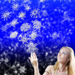 The girl and magic snowflakes — Stock Photo