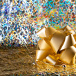Gold bow on an abstract  background - Stock Photo