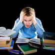 Royalty-Free Stock Photo: The teenager with a heap of textbooks. Was tired of homeworks.