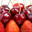 Sweet cherry and berry of strawberry — Stock Photo