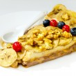 Royalty-Free Stock Photo: Banana dessert with nuts and berries