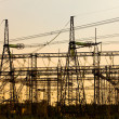Stock Photo: High-voltage line of electricity transmissions on sunset
