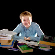 Pupil schoolboy with pile of textbooks — Stock Photo #4601354
