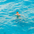 Teenager has a rest on turquoise transparent water of ocean — Stock Photo #4645031