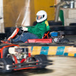 The man at the wheel go-cart racing on training — Stock Photo