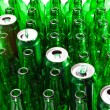 Empty glass beer bottles and cans — Stock Photo
