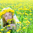 Young pretty woman in wreath of dandelions — Stock Photo #4645077