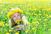 Young pretty woman in wreath of dandelions — Stock Photo