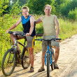 The father with the son on bicycles — Stock Photo #4765460