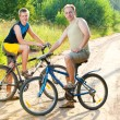 The father with the son on bicycles — Stock Photo #4765477