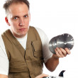 The man, the builder, chooses a detachable disk for the tool — Stock Photo #4765483