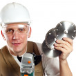 The man, the builder, in goggles and a helmet. — Stock Photo #4765484