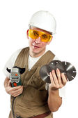 The man, the builder, in goggles and a helmet. — Stock Photo